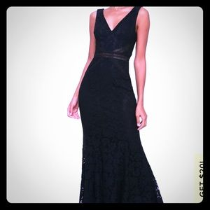 Never been worn lace gown with cut out details